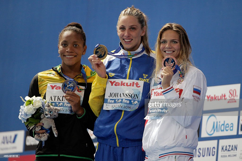 Gold medallist <a gi-track='captionPersonalityLinkClicked' href=/galleries/search?phrase=Jennie+Johansson&family=editorial&specificpeople=5130731 ng-click='$event.stopPropagation()'>Jennie Johansson</a> of Sweden poses with silver medallist <a gi-track='captionPersonalityLinkClicked' href=/galleries/search?phrase=Alia+Atkinson&family=editorial&specificpeople=881789 ng-click='$event.stopPropagation()'>Alia Atkinson</a> of Jamaica and bronze medallist Yuliya Efimova of Russia during the medal ceremony for the Women's 50m Breaststroke Final on day sixteen of the 16th FINA World Championships at the Kazan Arena on August 9, 2015 in Kazan, Russia.
