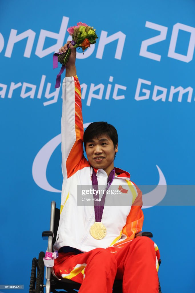 Gold medallist Jianping Du of China poses on the podium during the medal ceremony for the Men's 50m Breaststroke - SB2 final on day 1 of the London 2012 Paralympic Games at Aquatics Centre on August 30, 2012 in London, England.
