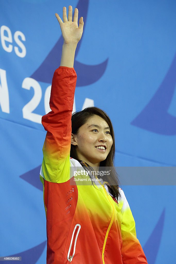 Gold medallist <a gi-track='captionPersonalityLinkClicked' href=/galleries/search?phrase=Jiao+Liuyang+-+Swimmer&family=editorial&specificpeople=4058032 ng-click='$event.stopPropagation()'>Jiao Liuyang</a> of China waves to the spectators during the women's 200m butterfly final medal ceremony on day five of 2014 Asian Games at Munhak Park Tae-hwan Aquatics Center on September 23, 2014 in Incheon, South Korea.