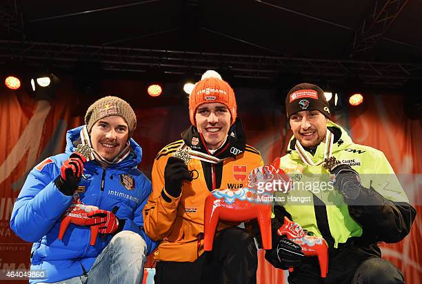 Gold medallist Johannes Rydzek of Germany poses with silver medallist Alessandro Pittin of Italy and bronze medallist Jason Lamy Chappuis of France...