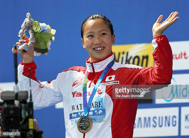 Gold medallist Kanako Watanabe of Japan celebrates on the podium at the medal ceremony for the Women's 200m Breaststroke on day fourteen of the 16th...