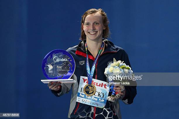 Gold medallist Katie Ledecky of the United States poses during the medal ceremony for the Women's 1500m Freestyle Final on day eleven of the 16th...