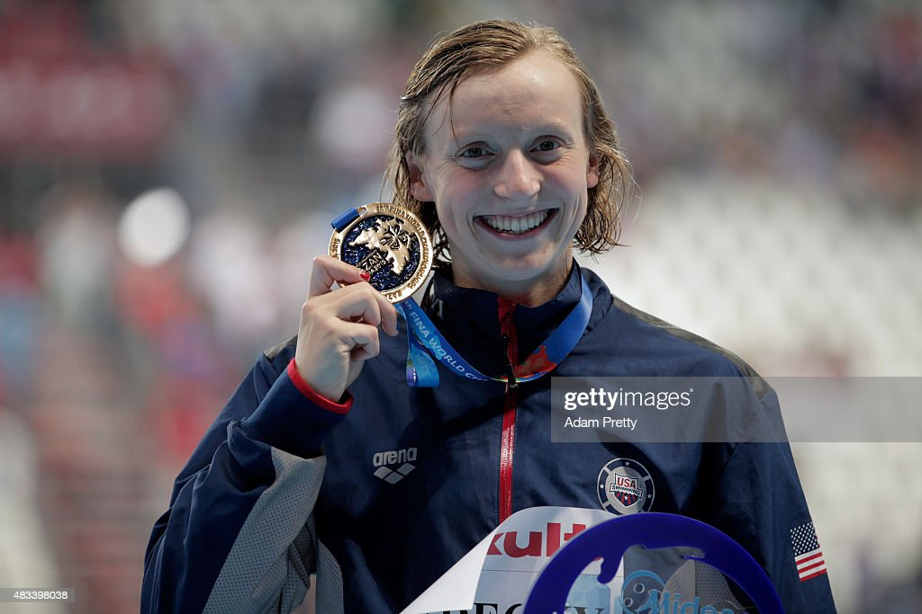 Gold medallist <a gi-track='captionPersonalityLinkClicked' href=/galleries/search?phrase=Katie+Ledecky&family=editorial&specificpeople=9595921 ng-click='$event.stopPropagation()'>Katie Ledecky</a> of the United States poses during the medal ceremony after setting a new world record of 8:07.39 in the Women's 800m Freestyle Final on day fifteen of the 16th FINA World Championships at the Kazan Arena on August 8, 2015 in Kazan, Russia.