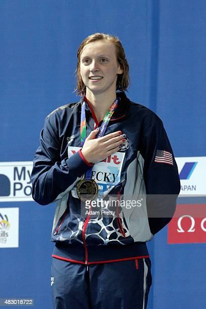 Gold medallist Katie Ledecky of the United States sings the national anthem during the medal ceremony for the Women's 200m Freestyle Final on day...