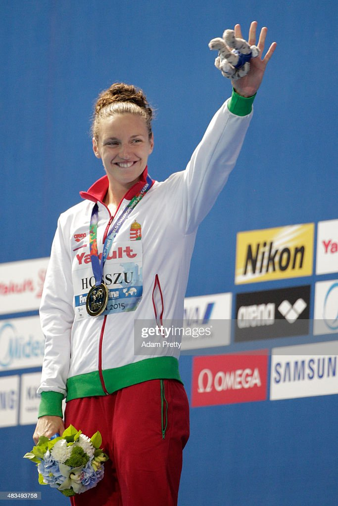 Gold medallist <a gi-track='captionPersonalityLinkClicked' href=/galleries/search?phrase=Katinka+Hosszu&family=editorial&specificpeople=2124249 ng-click='$event.stopPropagation()'>Katinka Hosszu</a> of Hungary celebrates during the medal ceremony for the Women's 400m Individual Medley Final on day sixteen of the 16th FINA World Championships at the Kazan Arena on August 9, 2015 in Kazan, Russia.