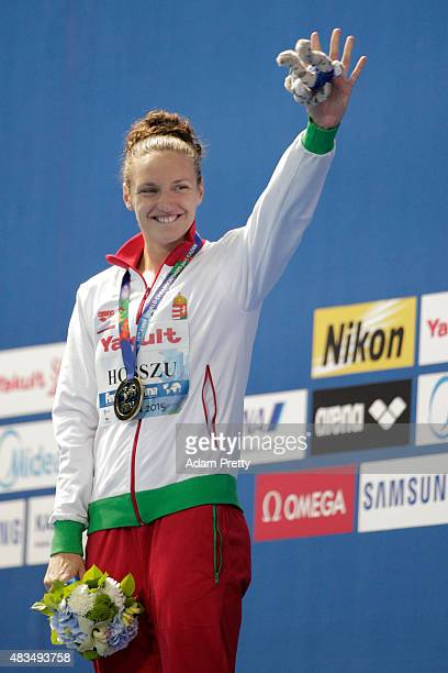 Gold medallist Katinka Hosszu of Hungary celebrates during the medal ceremony for the Women's 400m Individual Medley Final on day sixteen of the 16th...