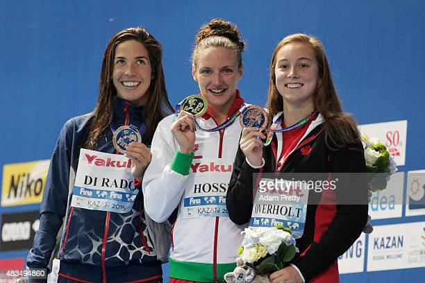 Gold medallist Katinka Hosszu of Hungary poses with silver medallist Maya Di Rado of the United States and bronze medallist Emily Overholt of Canada...