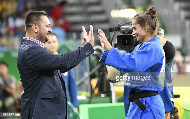 Gold medallist Kosovo's Majlinda Kelmendi celebrates with her coach after women's 52kg judo final at the Rio 2016 Olympic Games in Rio de Janeiro on...
