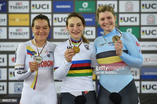 Gold medallist Kristina Vogel of Germany poses with silver medallist Martha Bayona Pineda of Colombia and bronze medallist Nicky Degrendele of...