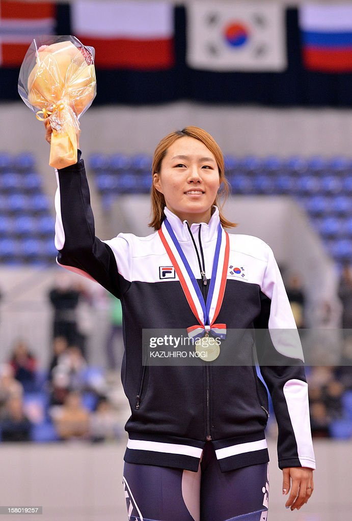 Gold medallist Lee Sang-Hwa of South Korea celebrates on the podium during the awards ceremony for the women's 500 meters competition at the World Cup speed skating event at the Nagano M-Wave ice arena on December 9, 2012.