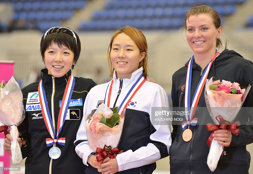 Gold medallist Lee Sang-Hwa of South Korea (C), silver medallist Nao Kodaira of Japan (L) and bronze medallist Heather Richardson of the US (R) celebrate on the podium during the awards ceremony for the women's 500 meters competition at the World Cup speed skating at the Nagano M-Wave ice arena on December 8, 2012. Lee clocked the fastest time of 37.63 seconds for the top podium spot.