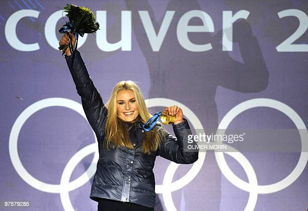 US gold medallist Lindsey Vonn stands on the podium during the medal ceremony for the Alpine skiing Ladies downhill event of the Vancouver 2010...