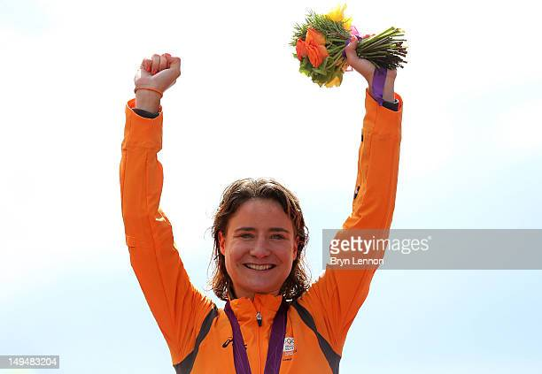 Gold medallist Marianne Vos of Netherlands celebrates during the Victory Ceremony after the Women's Road Race Road Cycling on day two of the London...