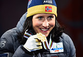 Gold medallist Marit Bjoergen of Norway poses with her medal during the medal ceremony for the Women's CrossCountry Sprint during the FIS Nordic...