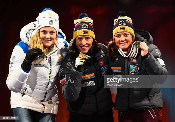 Gold medallist Marit Bjoergen of Norway poses with silver medallist Stina Nilsson of Sweden and bronze medallist Maiken Caspersen Falla of Norway...