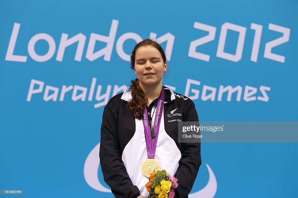 Gold medallist Mary Fisher of New Zealand poses on the podium during the medal ceremony for the Women's 200m Individual Medley - SM11 final on day 10 of the London 2012 Paralympic Games at Aquatics Centre on September 8, 2012 in London, England.