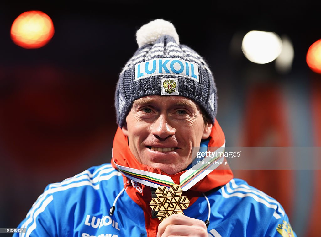 Gold medallist <a gi-track='captionPersonalityLinkClicked' href=/galleries/search?phrase=Maxim+Vylegzhanin&family=editorial&specificpeople=4779618 ng-click='$event.stopPropagation()'>Maxim Vylegzhanin</a> of Russia poses with his medal during the medal ceremony for the Men's 30km Cross-Country Skiathlon during the FIS Nordic World Ski Championships at the Lugnet venue on February 21, 2015 in Falun, Sweden.