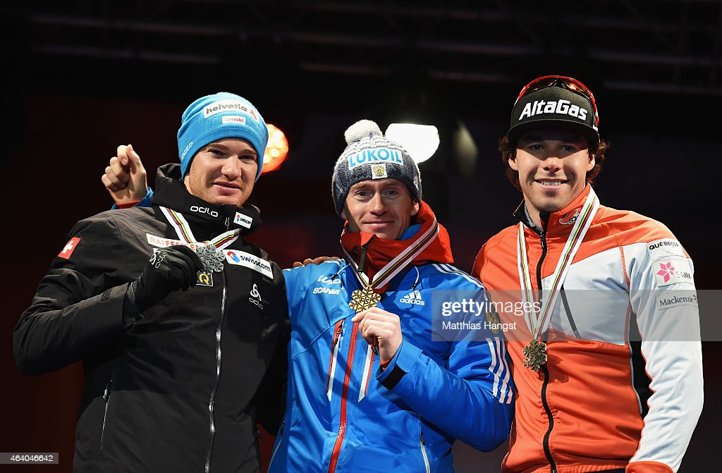 Gold medallist <a gi-track='captionPersonalityLinkClicked' href=/galleries/search?phrase=Maxim+Vylegzhanin&family=editorial&specificpeople=4779618 ng-click='$event.stopPropagation()'>Maxim Vylegzhanin</a> (C) of Russia poses with silver medallist <a gi-track='captionPersonalityLinkClicked' href=/galleries/search?phrase=Dario+Cologna&family=editorial&specificpeople=4779620 ng-click='$event.stopPropagation()'>Dario Cologna</a> (L) of Switzerland and bronze medallist <a gi-track='captionPersonalityLinkClicked' href=/galleries/search?phrase=Alex+Harvey+-+Skier&family=editorial&specificpeople=6719953 ng-click='$event.stopPropagation()'>Alex Harvey</a> of Canada during the medal ceremony for the Men's 30km Cross-Country Skiathlon during the FIS Nordic World Ski Championships at the Lugnet venue on February 21, 2015 in Falun, Sweden.