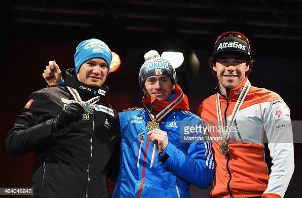 Gold medallist Maxim Vylegzhanin of Russia poses with silver medallist Dario Cologna of Switzerland and bronze medallist Alex Harvey of Canada during...