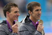 Gold medallist Michael Phelps of the United States and Silver medallist Ryan Lochte of the United States pose with the medlas won in the Men's 200m...