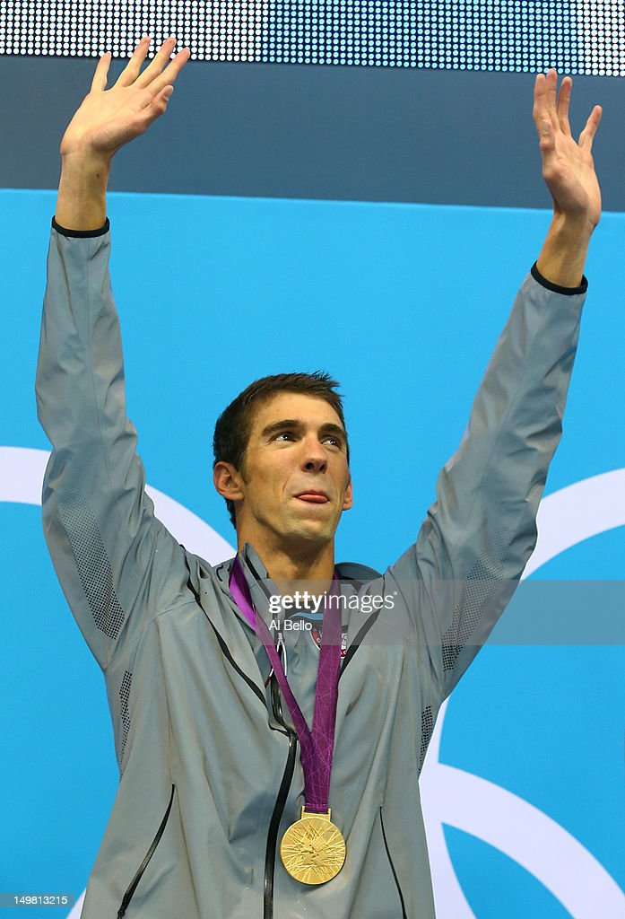 Gold medallist <a gi-track='captionPersonalityLinkClicked' href=/galleries/search?phrase=Michael+Phelps&family=editorial&specificpeople=162698 ng-click='$event.stopPropagation()'>Michael Phelps</a> of the United States celebrates on the podium in the medal ceremony for the Men's 4x100m medley Relay Final on Day 8 of the London 2012 Olympic Games at the Aquatics Centre on August 4, 2012 in London, England.