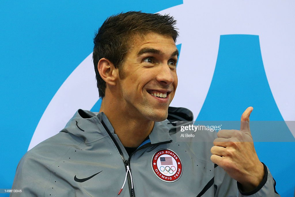 Gold medallist <a gi-track='captionPersonalityLinkClicked' href=/galleries/search?phrase=Michael+Phelps&family=editorial&specificpeople=162698 ng-click='$event.stopPropagation()'>Michael Phelps</a> of the United States gives the thumbs up from the podium in the medal ceremony for the Men's 4x100m medley Relay Final on Day 8 of the London 2012 Olympic Games at the Aquatics Centre on August 4, 2012 in London, England.