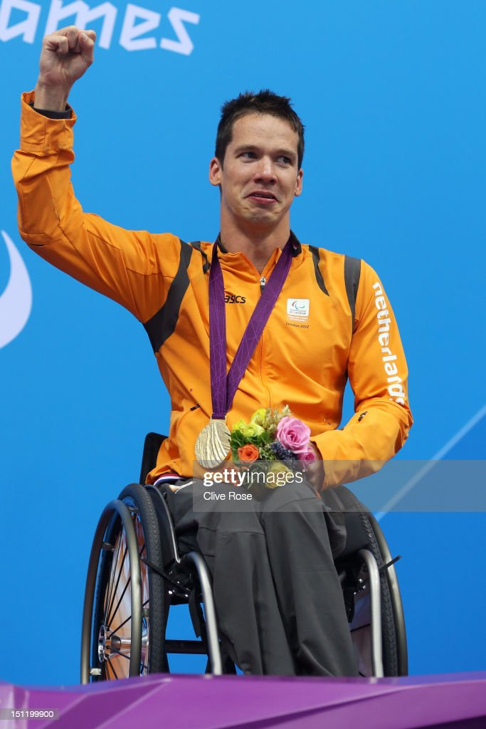 Gold medallist Michael Schoenmaker of Netherlands poses on the podium during the medal ceremony for the Men's 50m Breaststroke - SB3 final on day 5 of the London 2012 Paralympic Games at Aquatics Centre on September 3, 2012 in London, England.