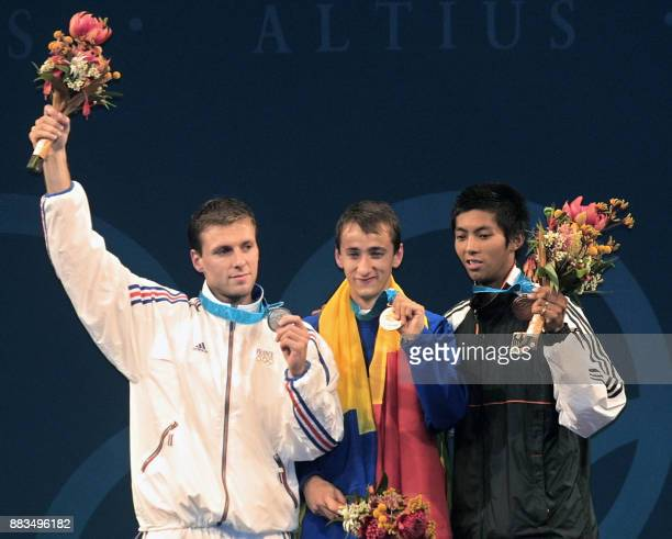 Gold Medallist Mihai Claudiu Covaliu of Romania stands with Silver Medallist Mathieu Gourdain of France and Bronze Medallist Wiradech Kothny of...