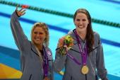 Gold medallist Missy Franklin of the United States and bronze medallist Elizabeth Beisel of the United States celebrate following the medal ceremony...