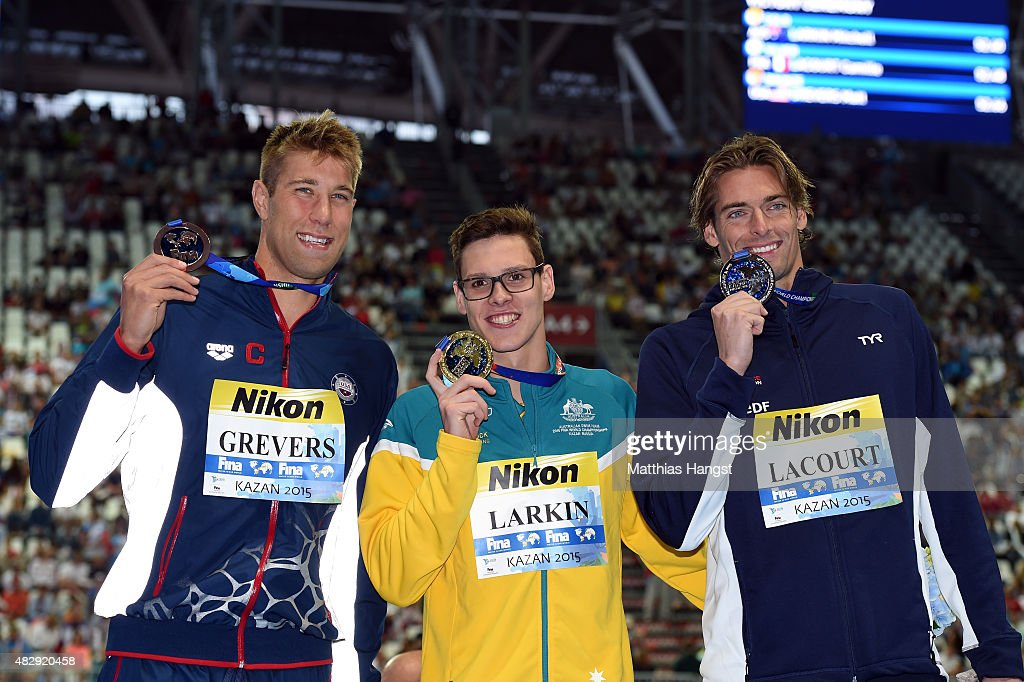 Gold medallist <a gi-track='captionPersonalityLinkClicked' href=/galleries/search?phrase=Mitch+Larkin&family=editorial&specificpeople=7619818 ng-click='$event.stopPropagation()'>Mitch Larkin</a> of Australia poses with silver medallist <a gi-track='captionPersonalityLinkClicked' href=/galleries/search?phrase=Camille+Lacourt&family=editorial&specificpeople=4365269 ng-click='$event.stopPropagation()'>Camille Lacourt</a> of France and bronze medallist <a gi-track='captionPersonalityLinkClicked' href=/galleries/search?phrase=Matt+Grevers&family=editorial&specificpeople=2499373 ng-click='$event.stopPropagation()'>Matt Grevers</a> of the United States during the medal ceremony for the Men's 100m Backstroke Final on day eleven of the 16th FINA World Championships at the Kazan Arena on August 4, 2015 in Kazan, Russia.