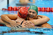 Gold medallist Natalie du Toit of South Africa is congratulated by silver medallist Stephanie Millward of Great Britain after competing in the...