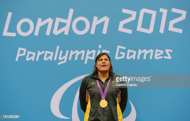 Gold medallist Natalie du Toit of South Africa poses on the podium during the medal ceremony for the Women's 200m Individual Medley SM9 final on day...