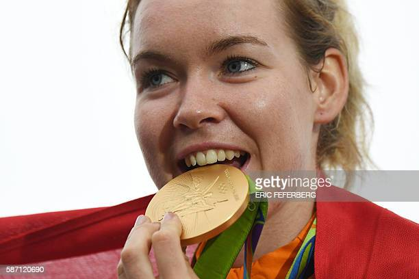 Gold medallist Netherlands' Anna Van Der Breggen poses on the podium after the Women's road cycling race at the Rio 2016 Olympic Games in Rio de...