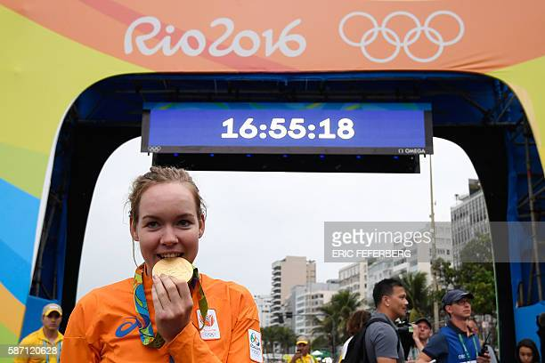 Gold medallist Netherlands' Anna Van Der Breggen poses with her medal after winning the Women's road cycling race at the Rio 2016 Olympic Games in...