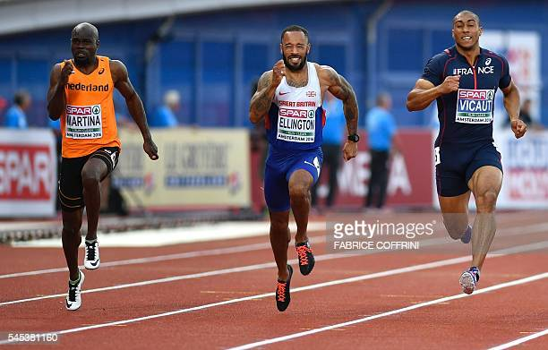 Gold medallist Netherland's Churandy Martina 5th placed Britain's James Ellington and Bronze medallist France's Jimmy Vicaut compete in the men's 100...