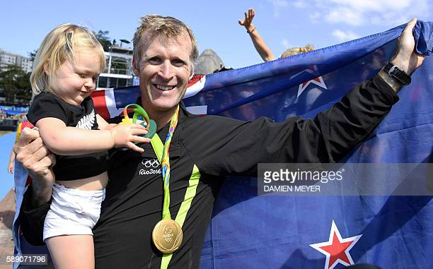 Gold medallist New Zealand's Mahe Drysdale celebrates with his gold medal after the podium of the Men's Single Sculls final rowing competition at the...