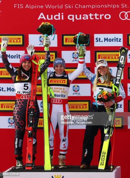 Gold medallist Nicole Schmidhofer of Austria poses with silver medallist Tina Weirather of Liechtenstein and bronze medallist Lara Gut of Switzerland...