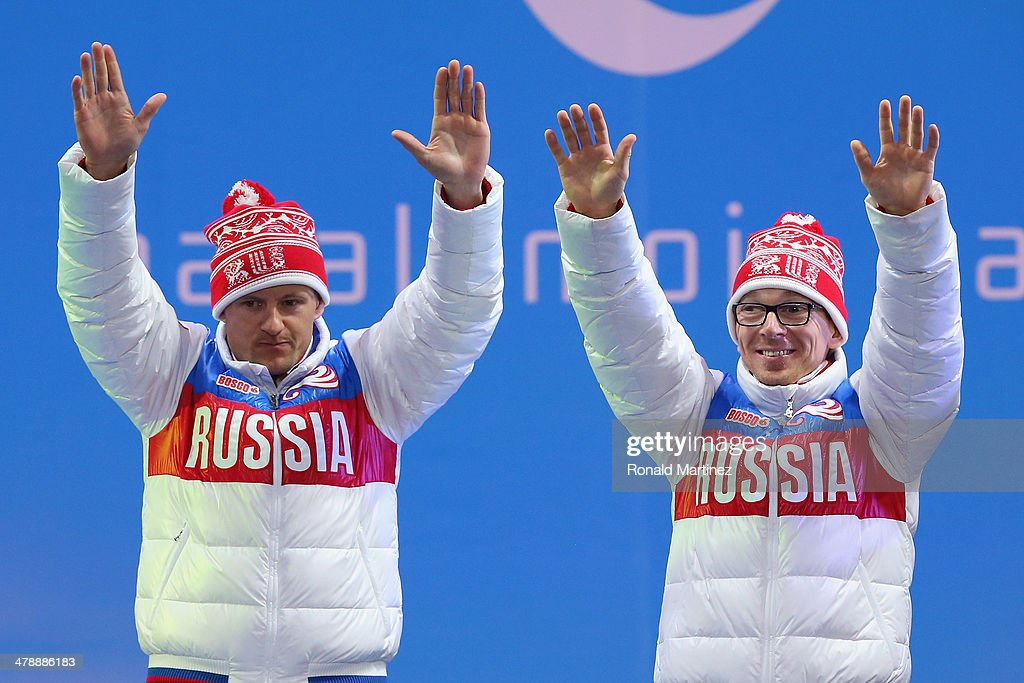 Gold medallist Nikolay Polukhin (R) of Russia and guide Andrey Tokarev (L) celebrate at the medal ceremony for the the Women's 12.5km Visually Impaired Biathlon on day eight of the Sochi 2014 Paralympic Winter Games at Laura Cross-country Ski & Biathlon Center on March 15, 2014 in Sochi, Russia.