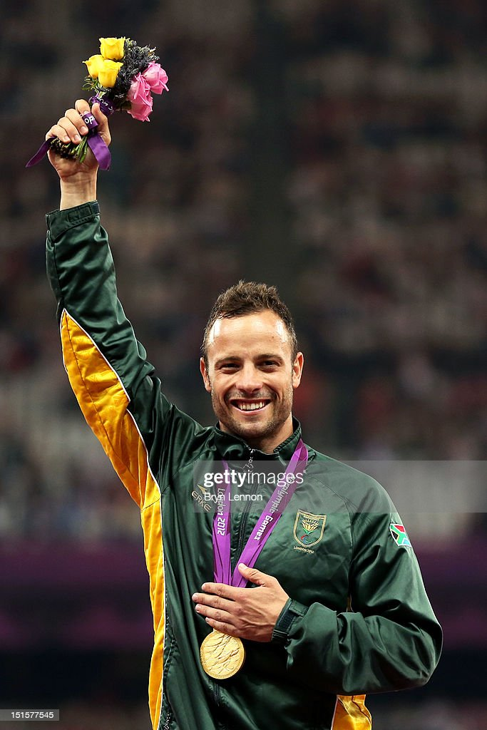 Gold medallist <a gi-track='captionPersonalityLinkClicked' href=/galleries/search?phrase=Oscar+Pistorius&family=editorial&specificpeople=224406 ng-click='$event.stopPropagation()'>Oscar Pistorius</a> of South Africa poses on the podium during the medal ceremony for the Men's 400m T44 Final on day 10 of the London 2012 Paralympic Games at Olympic Stadium on September 8, 2012 in London, England.