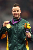 Gold medallist Oscar Pistorius of South Africa poses on the podium during the medal ceremony for the Men's 400m T44 Final on day 10 of the London...