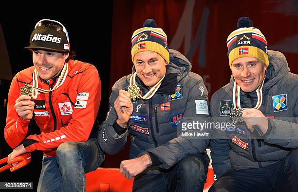 Gold medallist Petter Jr Northug of Norway poses with silver medallist Alex Harvey of Canada and bronze medallist Ola Vigen Hattestad of Norway...
