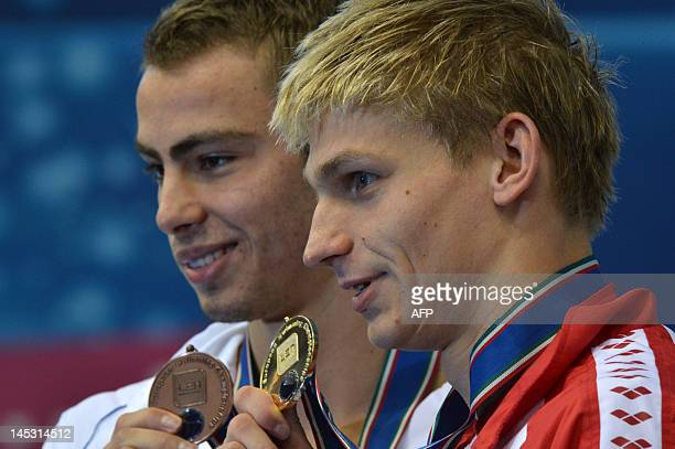 Gold medallist Poland's Radoslaw Kawecki and bronze medallist Israel's Yakov Yan Toumarkin pose on the podium after the final of the men's 200metre...