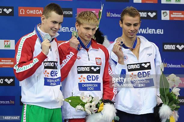 Gold medallist Poland's Radoslaw Kawecki silver medallist Hungary's Peter Bernek and bronze medallist Israel's Yakov Yan Toumarkin pose on the podium...