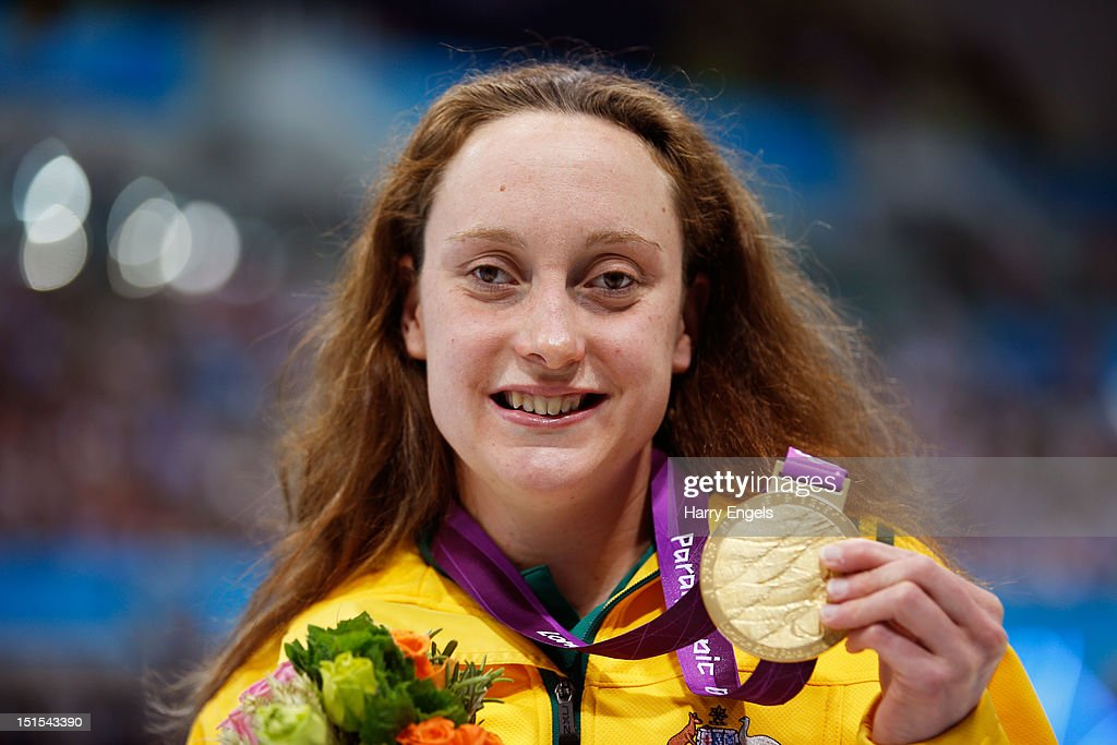Gold medallist Prue Watt of Australia poses on the podium during the medal ceremony for the Women's 100m Breaststroke - SB13 final on day 10 of the London 2012 Paralympic Games at Aquatics Centre on September 8, 2012 in London, England.