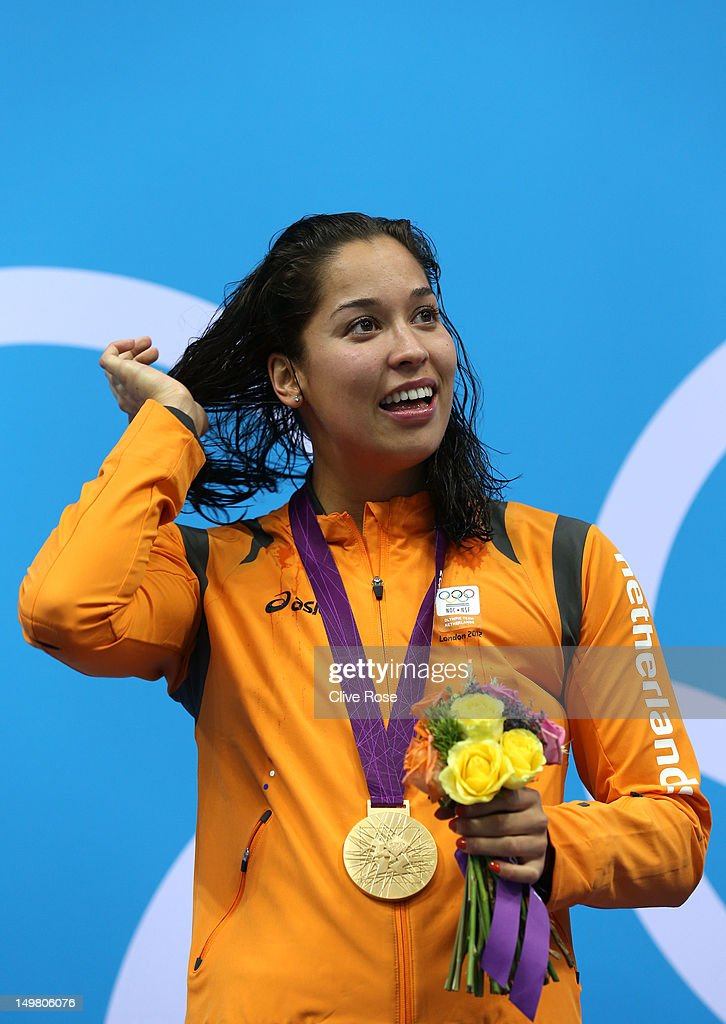 Gold medallist <a gi-track='captionPersonalityLinkClicked' href=/galleries/search?phrase=Ranomi+Kromowidjojo&family=editorial&specificpeople=4209840 ng-click='$event.stopPropagation()'>Ranomi Kromowidjojo</a> of Netherlands looks on from the podium during the medal ceremony for the Women's 50m Freestyle Final on Day 8 of the London 2012 Olympic Games at the Aquatics Centre on August 4, 2012 in London, England.