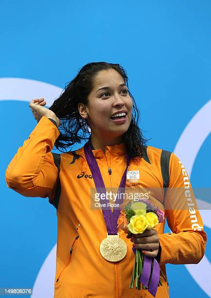 Gold medallist Ranomi Kromowidjojo of Netherlands looks on from the podium during the medal ceremony for the Women's 50m Freestyle Final on Day 8 of...
