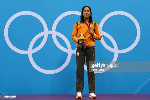 Gold medallist Ranomi Kromowidjojo of Netherlands poses on the podium during the medal ceremony Women's 50m Freestyle Final on Day 8 of the London...