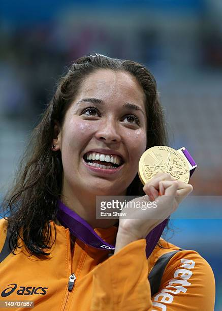 Gold medallist Ranomi Kromowidjojo of the Netherlands celebrates with the medal won in the Women's 100m Freestyle Final on Day 6 of the London 2012...