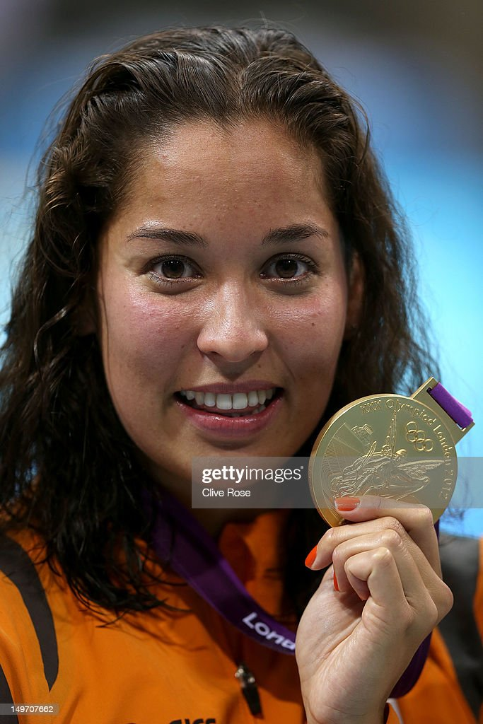 Gold medallist Ranomi Kromowidjojo of the Netherlands poses with the medal won in the Women's 100m Freestyle Final on Day 6 of the London 2012 Olympic Games at the Aquatics Centre on August 2, 2012 in London, England.