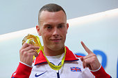 Gold medallist Richard Kilty of Great Britain Northern Ireland on the podium during the medal ceremony for Men's 60 metres during day three of the...